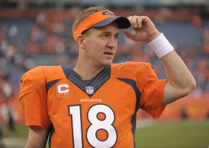 Denver Broncos quarterback Peyton Manning (18) watches play from the sidelines late in the fourth quarter against the Philadelphia Eagles in an NFL football game, Sunday, Sept. 29, 2013, in Denver. Denver won 52-20. (AP Photo/Jack Dempsey)