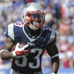 New England Patriots' Dion Lewis (33) plays during the first half of an NFL football game against the Buffalo Bills Sunday, Sept. 20, 2015, in Orchard Park, N.Y. (AP Photo/Gary Wiepert)